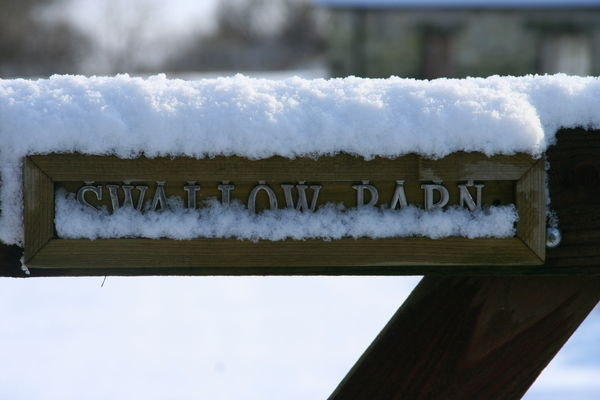 Gate sign covered in snow